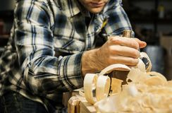 Woodworker planing wood in his workshop Royalty Free Stock Photo