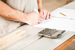 Woodworker planning calculating and measuring Royalty Free Stock Photography