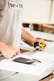 Woodworker planning calculating and measuring Royalty Free Stock Photos