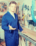 Woodworker practising his skills with milling cutter Royalty Free Stock Image