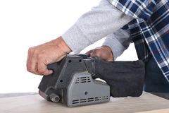 Woodworker Sanding Board Royalty Free Stock Image