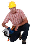 Woodworker with saw Royalty Free Stock Photography
