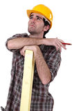 Woodworker thinking and calculating Stock Photos