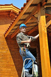 Woodworker three. A carpenter working in his house Royalty Free Stock Photos