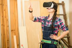 Woodworker touch screen with VR device Stock Photo