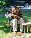 Woodworker is twining making souvenirs from the tat withe. Klaipeda, Lithuania. Stock Photo