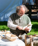 Woodworker is twining making souvenirs from the tat withe. Klaipeda, Lithuania. Royalty Free Stock Photos