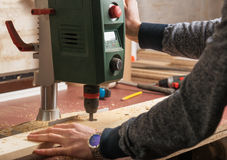Woodworker using drilling machine Stock Photography