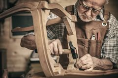 Woodworker in workshop royalty free stock photo