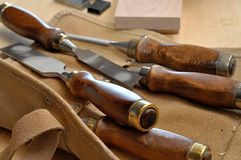 Woodworkers chisel set. Carpenters woodworking chisels with leather pouch Royalty Free Stock Images