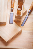 Woodworkers plane and carpentry chisels on wooden Royalty Free Stock Images