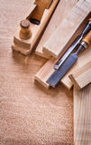Woodworkers plane planks and carpentry chisels on Stock Images