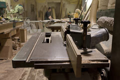 Woodworking. Carpentry workshop - tools, machinery, planks, sawdust Stock Image