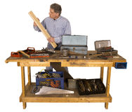 Woodworking, Active Man With Hobby as Handyman. An active man is at his hobby workbench filled with tools. He is a woodworker who enjoys building things out of Stock Photos