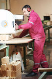 Woodworking of beam at factory Stock Images