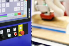 Woodworking equipment with CNC control panel. On the foreground. Selective focus stock images