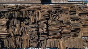 Woodworking industry. Raw materials for woodworking. Logs in stacks aerial photography with a drone.  royalty free stock photography