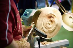 Woodworking on lathe Stock Photo