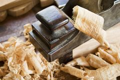 Woodworking: Plane. Woodworking plane with wood curls in foreground Royalty Free Stock Images