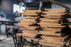 Woodworking plant. Boards stacked in pile Royalty Free Stock Photography