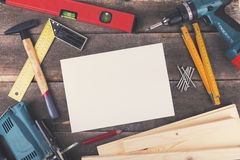 Woodworking project, tools and blank sheet on wooden table Stock Images