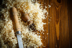 Woodworking tools. Chisel with sawdust . Woodworking tools. Chisel with sawdust on a wooden table royalty free stock images