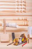 Woodworking tools on steps of wooden lader Royalty Free Stock Photos