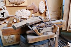 Woodworking tools with the wooden ornaments Royalty Free Stock Image