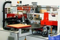 Woodworking veneer. Automatic woodworking machine for processing veneer boards Stock Photos