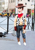 Woody In The Big Apple. Woody the character from Toys Story   is waiting for clients to be photographed with him in manhattan,ny Royalty Free Stock Photos