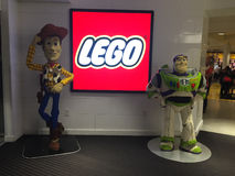 Woody and Buzz. Statues of cartoon characters Woody and Buzz Lightyear are made entirely of legos.  These statues are displayed at the entrance of the Lego store Royalty Free Stock Images