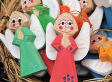 Woody, hand colored angels figures. Christmas decoration Royalty Free Stock Images