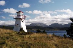 Woody Point Lighthouse. Looking over Bonne Bay toward Gros Morne mountain in the distance Royalty Free Stock Image