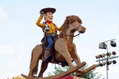 Woody from Toy Story on a rocking horse on float in Disneyland Parade. Woody from Toy Story is riding on a rocking horse on a float in Disneyland's A Christmas Stock Images