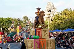 Woody from Toy Story on a rocking horse on float in Disneyland Parade. Woody from Toy Story is riding on a rocking horse on a float in Disneyland's A Christmas Royalty Free Stock Photo