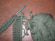 Wool. Work in progress with green wool royalty free stock photos