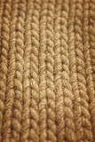 Wool background. Gray background of hand-knitted wool scarf stock photos