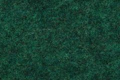 Wool background texture, green color, fabric, material, cloth. Close up. copy space royalty free stock image
