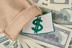 Wool bag with money. Wool bag with money close up. Top view royalty free stock image