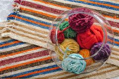 Wool balls in glass on wool blanket stock images