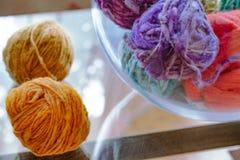 Wool balls in glass on wool blanket stock photo