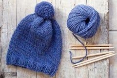 Wool blue hat, knitting needles and yarn Stock Image
