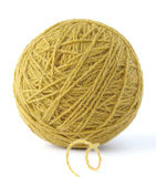 Wool clew. Yellow wool yarn clew on white background Stock Image