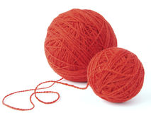 Wool clews. Two red wool yarn clews Stock Images