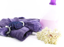 Wool clothes and detergent for laundry, on white Stock Photos