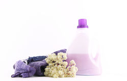Wool clothes and detergent for laundry, on white Stock Images