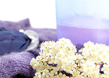 Wool clothes and detergent for laundry, on white Royalty Free Stock Images
