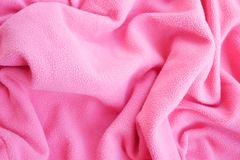 Wool clothes pink color textile material. Background royalty free stock photo