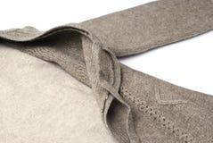Warm khaki Cashmere pullover knitwear. Wool coat Cashmere pullover knitted sweater royalty free stock photo