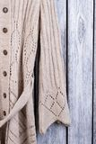 Wool coat sleeve material, close up. Flat lay, top view, wooden desk surface background royalty free stock images